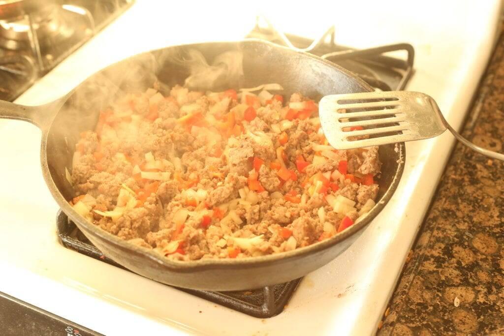 Browning sausage and veggies