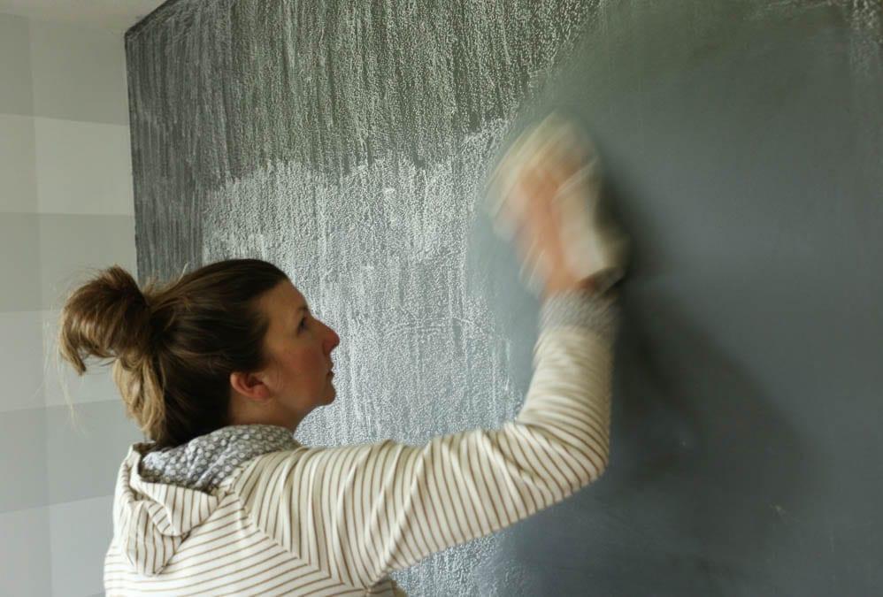 wiping chalkboard wall