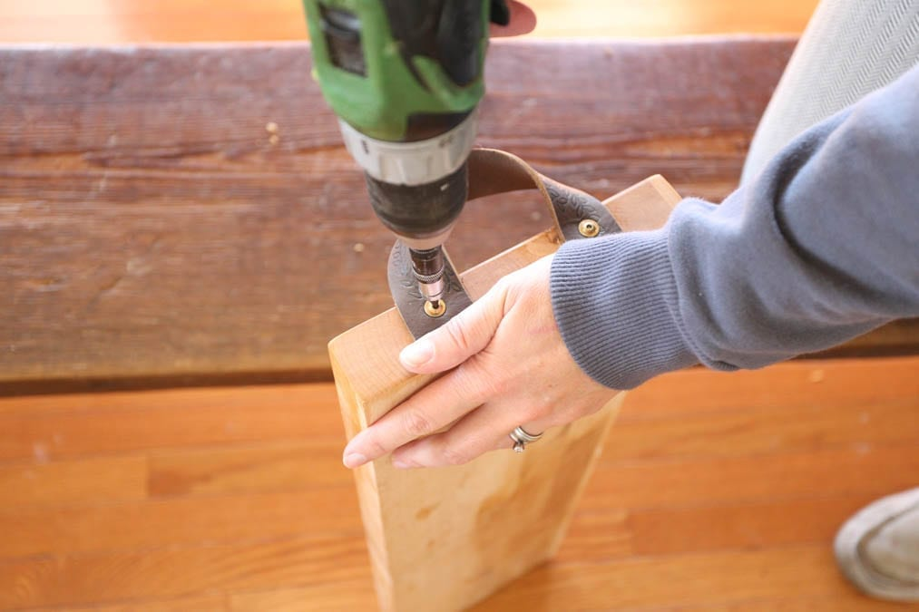 screwing the leather handles into the board