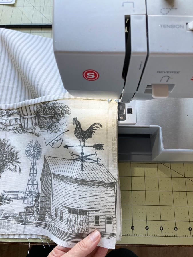 Sewing on the apron pocket