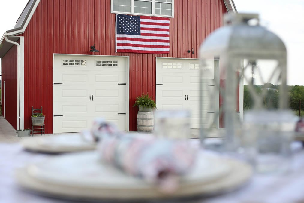American flag on a red barn