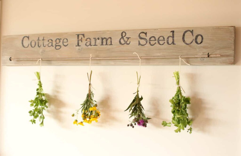 Now you just hang the dowel on the hooks and you are ready to go with your DIY Herb Drying Rack!
