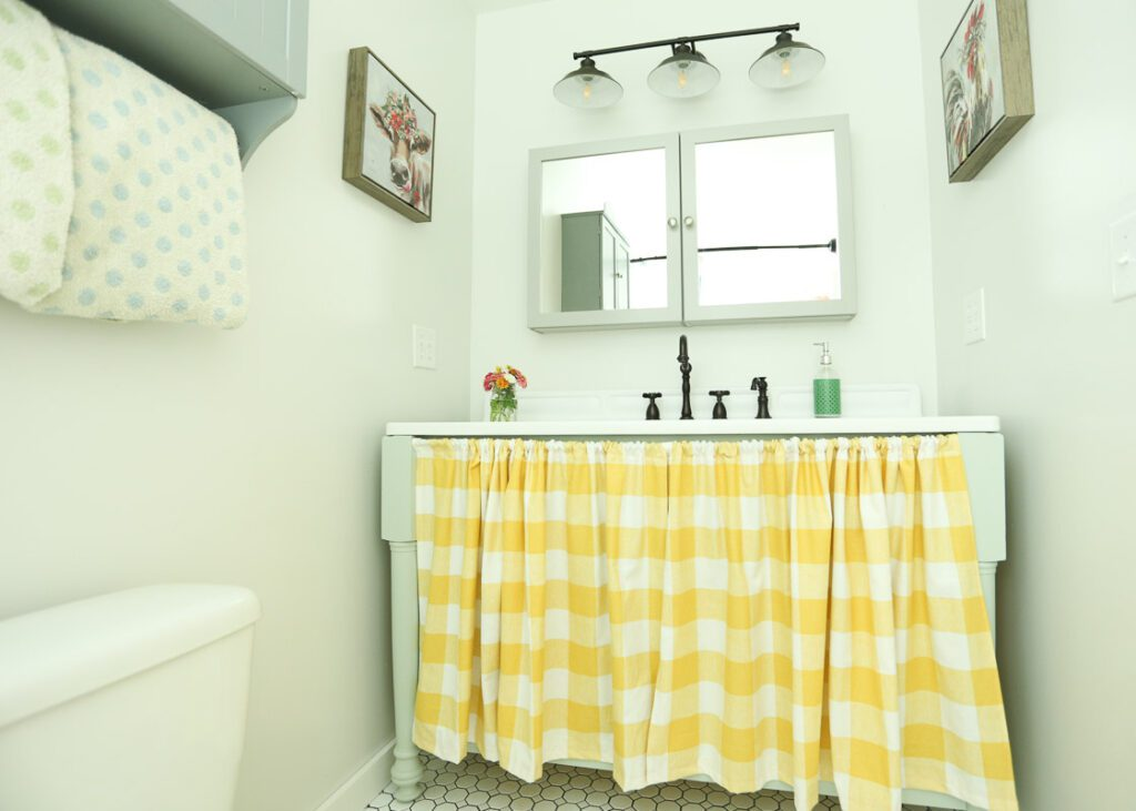 This bathroom has no windows and it was super difficult to photograph...that is why the lighting looks odd in some of the pictures.  The color of the curtain is more like the picture above, not so much the one below.